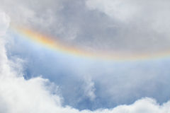 Colorful rainbow and cloud on blue sky Royalty Free Stock Photo