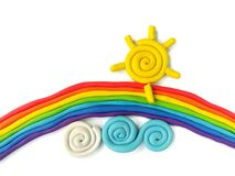 Colorful rainbow cloud sun plasticine clay, handmade beautiful sky dough. Colorful plasticine clay handmade are beautiful rainbow clouds and sun on white Royalty Free Stock Photos