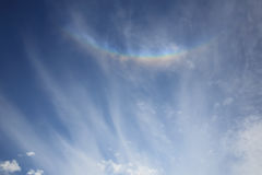 Colorful rainbow with clouds. Colorful rainbow radiate from the sun have clouds Royalty Free Stock Photo