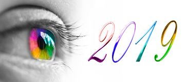 2019 and colorful rainbow eye header, 2019 new year greetings. Concept stock photo