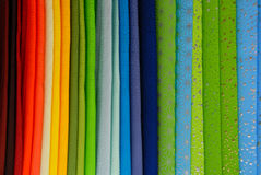 Colorful Rainbow of Fabrics in a Vertical Row Royalty Free Stock Images