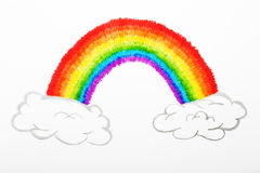 Colorful rainbow and fluffy clouds drawing, childhood conception Stock Photos