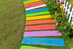 Colorful rainbow foot path garden decoration. Colorful rainbow foot path garden decoration funny park background Royalty Free Stock Photos
