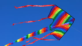 Colorful rainbow kite flying Royalty Free Stock Photos