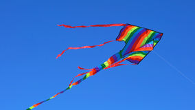 Colorful rainbow kite flying Royalty Free Stock Photography