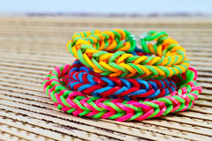 Colorful Rainbow loom bracelet rubber bands fashion close up.  Royalty Free Stock Images