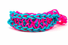 Colorful Rainbow loom bracelet rubber bands fashion close up.  Stock Photo