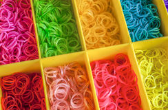 A Colorful Rainbow loom rubber bands in a box Stock Image