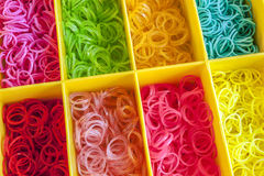 A Colorful Rainbow loom rubber bands in a box Stock Photography