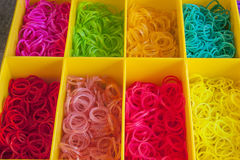 A Colorful Rainbow loom rubber bands in a box Royalty Free Stock Photography