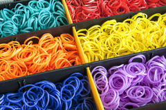 A Colorful Rainbow loom rubber bands in a box Stock Photos