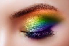 Colorful rainbow make-up on woman eye stock photos