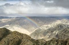 Colorful rainbow in the Nepalese mountains after the distant rai Stock Images