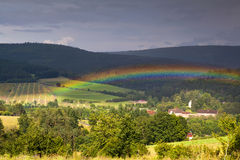 Colorful rainbow over mountains Royalty Free Stock Image