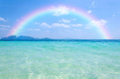 Colorful rainbow over a Tropical beach of Andaman Sea, Thailand Royalty Free Stock Photo