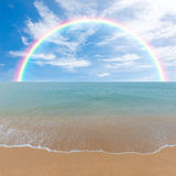 Colorful rainbow over a Tropical beach of Andaman Sea, Thailand Royalty Free Stock Photos