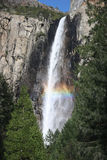 Colorful rainbow over Yosemite fall Stock Photos