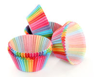 Colorful rainbow paper forms for cupcakes  on white Stock Images