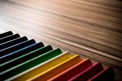 Colorful rainbow pencils on the brown table background. S Royalty Free Stock Photos