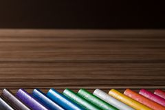 Colorful rainbow pencils on the brown table background. S Royalty Free Stock Images