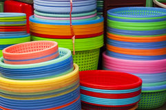 Colorful rainbow, plastic containers. On a market Stock Images