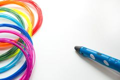 Colorful rainbow plastic filaments with 3D pen laying on white. New toy for child. 3d paintings and figures with their own hands. Colorful rainbow plastic stock photography
