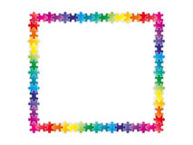 Colorful rainbow puzzle pieces forming a frame Royalty Free Stock Photos