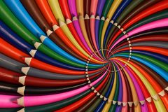 Colorful rainbow sharpen pencils spiral background pattern fractal. Pencils twisted background pattern. Abstract pencils rainbow s Royalty Free Stock Images