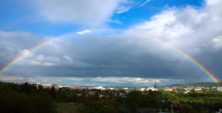 Colorful rainbow in sky over the city summer day Royalty Free Stock Image