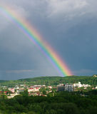 Colorful rainbow in sky over the city summer day Royalty Free Stock Images