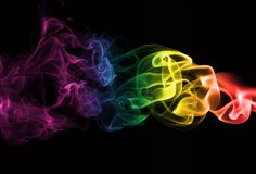 Serbia national smoke flag. Colorful rainbow smoke isolated on a black background Stock Image