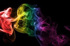Serbia national smoke flag. Colorful rainbow smoke isolated on a black background Stock Images