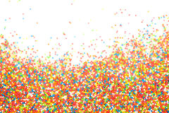 Colorful rainbow sprinkles backgroung. Colorful rainbow sprinkles for cake or dessert decoration Royalty Free Stock Photography