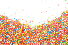 Colorful rainbow sprinkles backgroung. Colorful sprinkles for decorate cake and dessert Stock Image