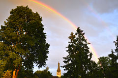Colorful rainbow after summer rain Stock Image