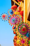 Colorful rainbow toy pinwheels and red lantern Royalty Free Stock Photography