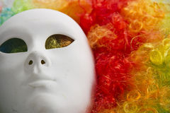 Colorful rainbow wig and venice carnival mask Stock Photos