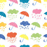 Colorful rainy seamless pattern. Vector rain background with doodle clouds and umbrellas Royalty Free Stock Images