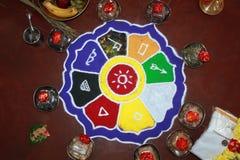 Colorful rangoli art, hindu puja items, flowers Stock Photo