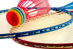 Colorful Raquet Sports. Badminton raquets red and blue with modified Shuttlecock Stock Image