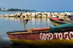 Colorful Rasta Color Fishing Boats By The Seaside Stock Photo
