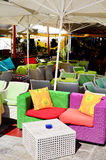 Colorful rattan  armchairs in a street coffee Stock Image