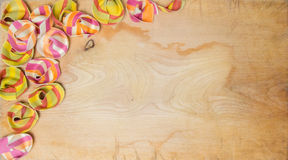 Colorful ravioli pasta covering the left upper side of a wooden surface on canvas Stock Photo