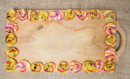 Colorful ravioli pasta placed on the border lines of a wooden surface Stock Photography
