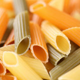 Colorful raw Penne Rigatoni noodles pasta with copyspace Royalty Free Stock Image
