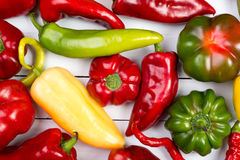 Colorful raw peppers on table - top view Royalty Free Stock Photos