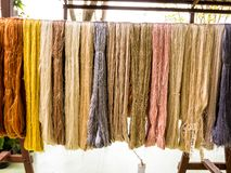 Colorful raw silk on clothes line stock photos
