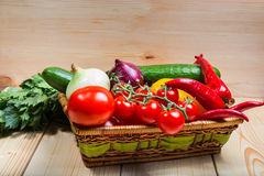 Colorful raw vegetables in a basket. Close up of various colorful raw vegetables in a basket Royalty Free Stock Image