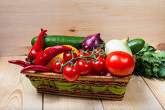 Colorful raw vegetables in a basket Stock Images