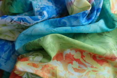 Colorful rayon fabric in soft folds. Colorful lightweight rayon fabric in soft folds Stock Images